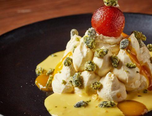 Mango shrikhand with rasmalai sauce and pistachio crumble